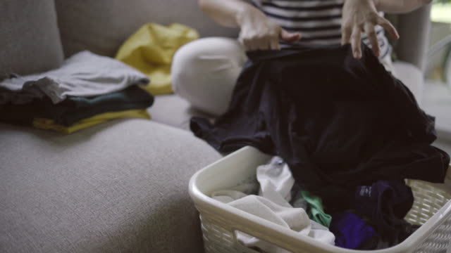 Mother collect clothes with son video