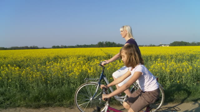 HD STEADY SHOT: Mother Cycling With Her Daughter video