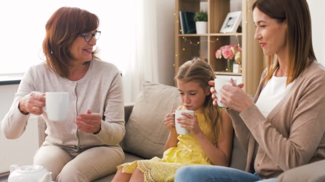 mother, daughter and grandmother having tea party - teapot stock videos & royalty-free footage