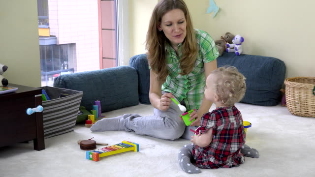 Mother develop her daughter imagination by eating invisible food from toy dish video
