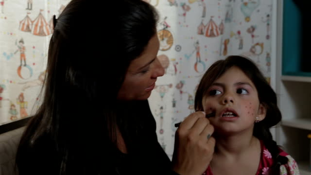 Mother Does Her Daughter's Make-up and They Smile to Each Other video