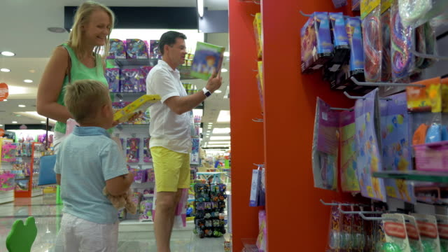 Mother, father and son in toy shop
