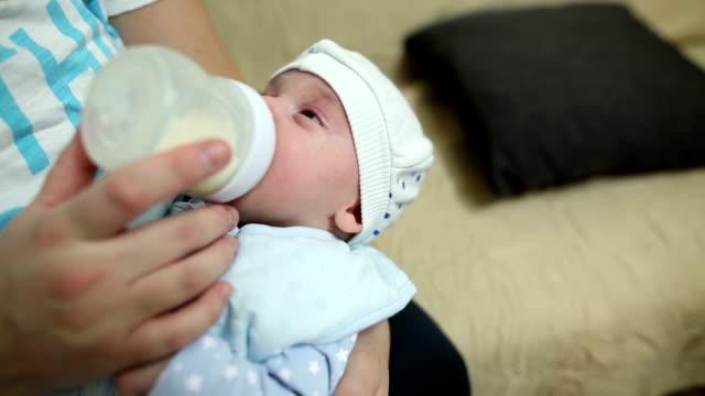 Mother feeding her new born baby boy video