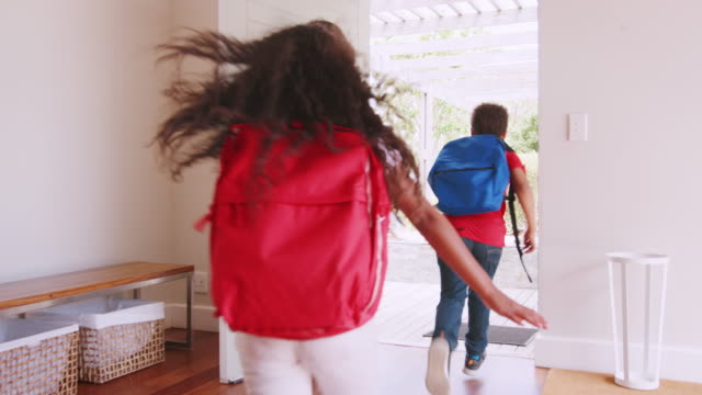 mother getting children ready to leave house for school - children video stock e b–roll