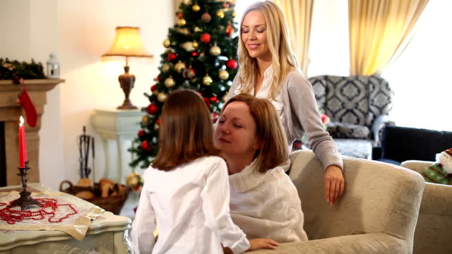 Mother granddauther and daughter at Christmas video