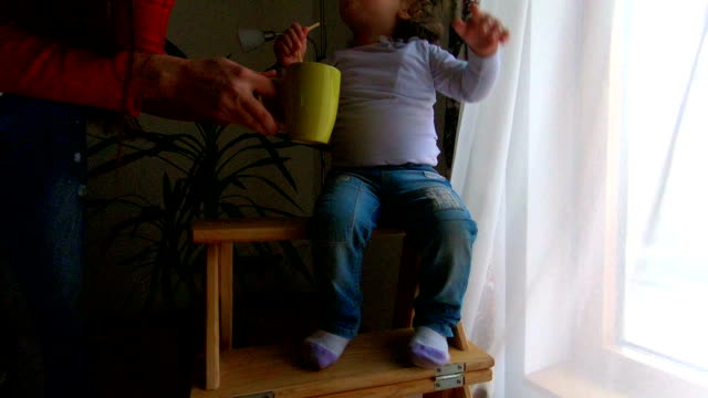 mother having tea party with daughter - mika video stock e b–roll