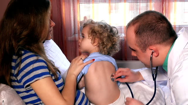 Mother hold child daughter for pediatrician doctor examination with stethoscope video