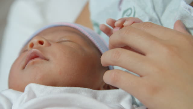Mother Holding Newborn Baby In Hospital Bed Shot On R3D video