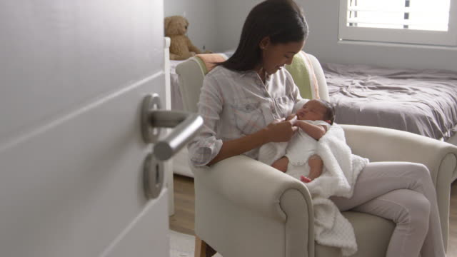 Mother Home from Hospital With Newborn Baby In Nursery video
