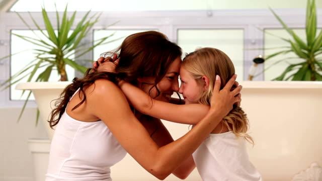 Mother hugging her little girl video