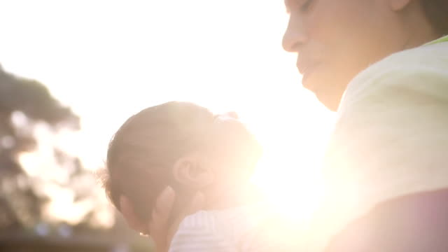 Mother Kisses Baby On Cheek video