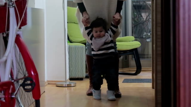 Mother learning baby how to walk video