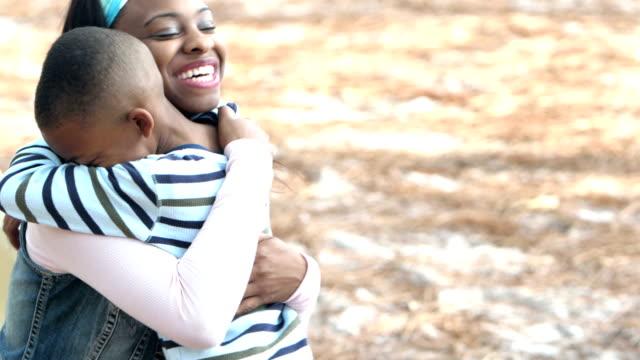 Mother, little boy talking, hugging video