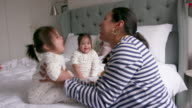 istock A mother playing a jumping game with her young children 1161220312