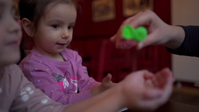 mother pouring hand sanitizer into daughter's hand - purezza video stock e b–roll