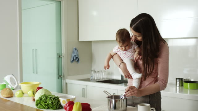 Mother preparing food for her baby video