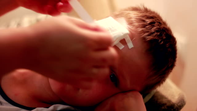 Mother Putting Bandage On Child video