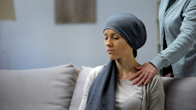 Mother putting hand on shoulder of her upset daughter with cancer, support Mother putting hand on shoulder of her upset daughter with cancer, support cancer illness stock videos & royalty-free footage