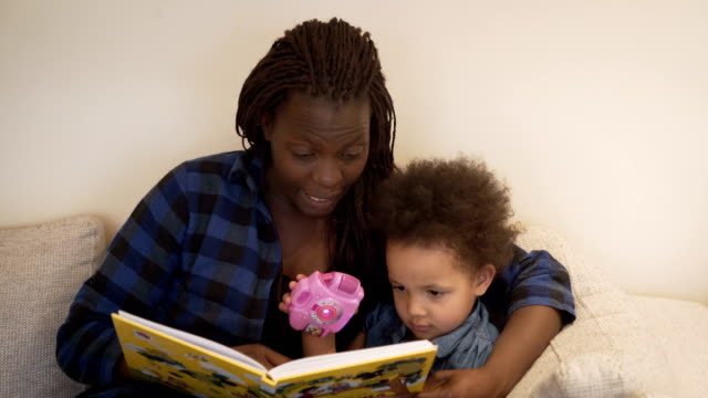 mother reads her daughter's fairy tale mother reads her daughter's fairy tale child care stock videos & royalty-free footage