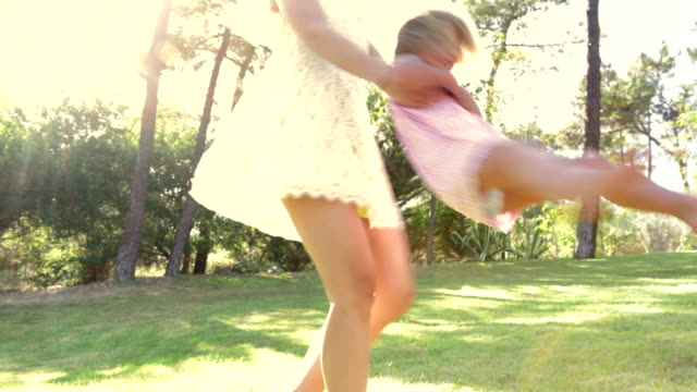 Mother Spinning Daughter Around On Country Walk video