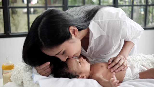 mother take care his asian boy or son in living room,.