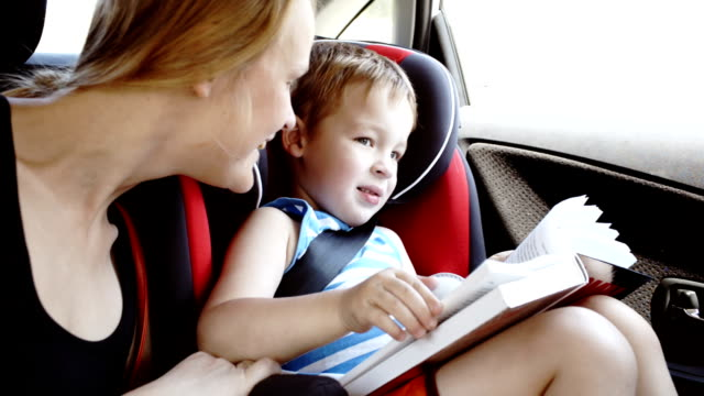 Mother talking to son while they in the car video