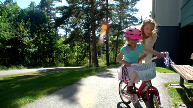 Mother Teaches her Daughter to Ride a Bicycle video