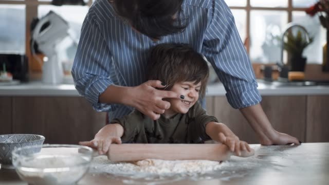 Mother Teases Her Son, Having Fun While Making Gingerbread Cookies Hardworking Blond Boy Preparing Gingerbread Cookies In Kitchen With His Mom cookie stock videos & royalty-free footage