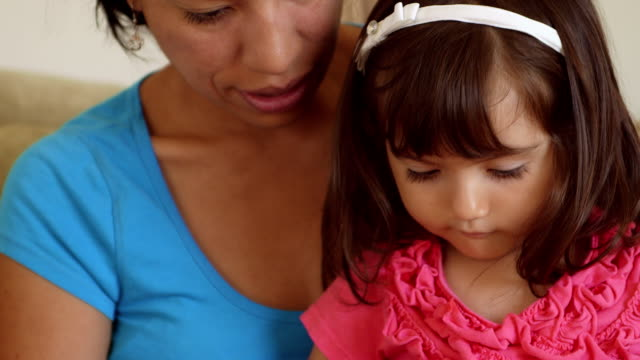Mother & Toddler Daughter Reading and Shaking Finger video