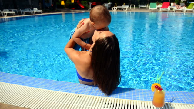 mother with baby boy in the pool video