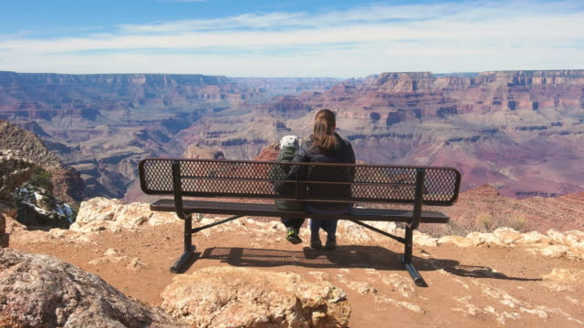 Mother with child looking at view in Grand Canyon National Park USA