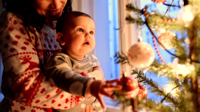 mother with daughter portrait at christmas mother with daughter portrait at christmas christmas ornament stock videos & royalty-free footage
