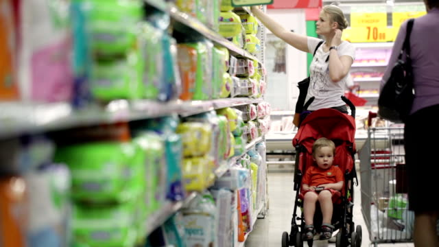 Mother with her boy in the supermarket video