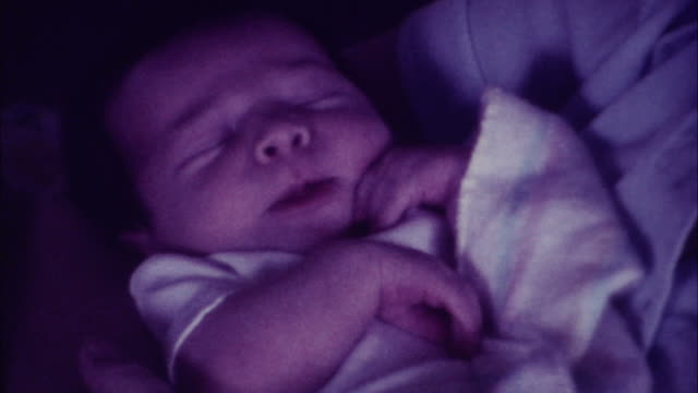 Mother with newborn in rocking chair 8mm film 70's video