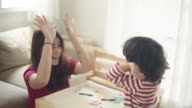 istock Mother with son studying at home 1215582895