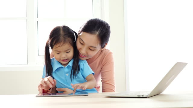 Mother working with laptop and Children At Home in holiday , SLOW MOTION