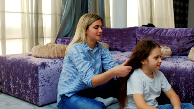 motherly love care mom braiding hair family bond video