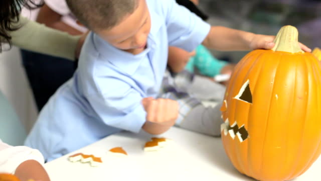 Mothers And Children Making Halloween Lanterns video
