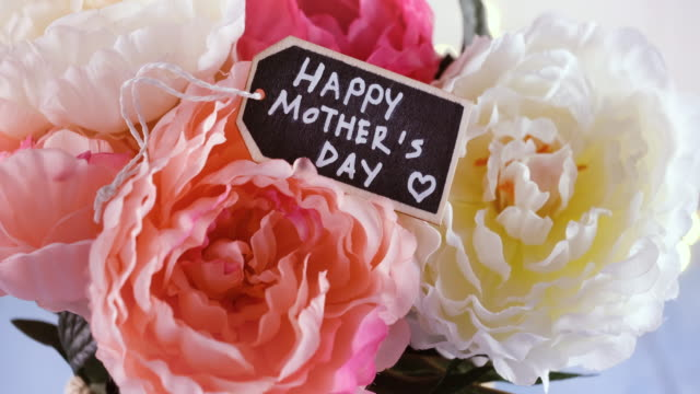 Mother`s Day arrangement and a greeting card Mother`s Day arrangement and a greeting card mothers day stock videos & royalty-free footage
