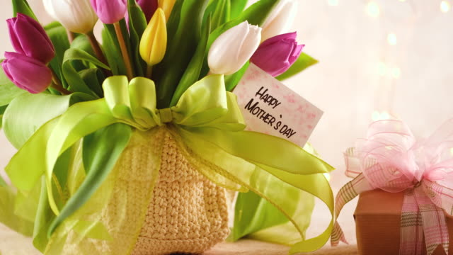 Mother`s Day arrangement with tulip bouquet and a gift box Mother`s Day arrangement with tulip bouquet and a gift box mothers day stock videos & royalty-free footage