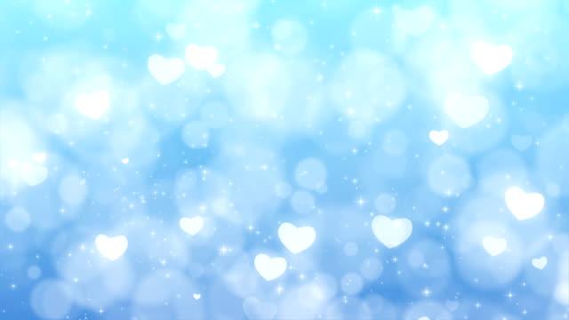 粒子、輝く心と母日背景。 - 母の日点の映像素材/bロール
