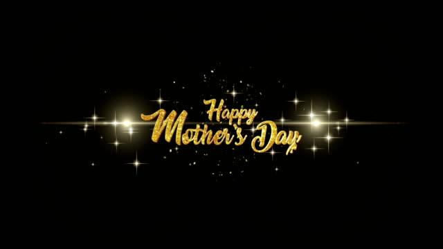 vidéos et rushes de les mères jour belle salutation apparence du texte de clignotant de particules avec fond de feux d'artifice or doré. - fête des mères