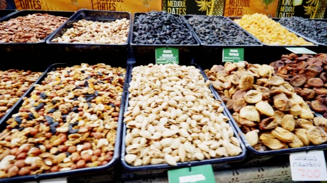 motion along display with different dry fruits and nuts