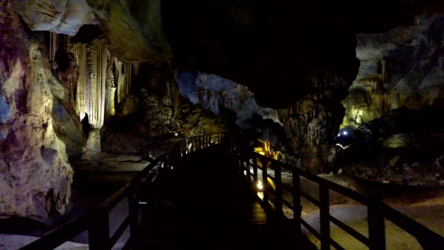 motion along staircase to huge karst cavern depth