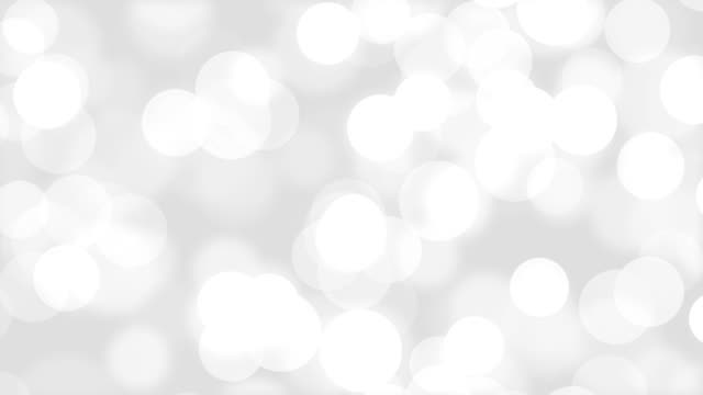 Motion bokeh seamless abstract gray white background Motion bokeh seamless abstract gray white background holiday stock videos & royalty-free footage