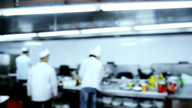 motion chefs of a restaurant kitchen video
