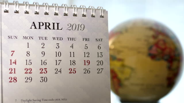 Motion of April 2019 calendar with blur earth globe turning background Motion of April 2019 calendar with blur earth globe turning background april stock videos & royalty-free footage