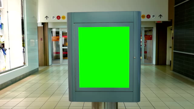 Motion of green billboard for your ad inside the shopping mall – Video