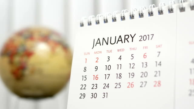 Motion of January 2017 calendar with blur earth globe turning background video