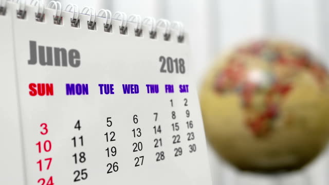 Motion of June 2018 calendar with blur earth globe turning background video